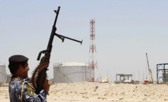 Iraq oilfield output suspended after ISIS