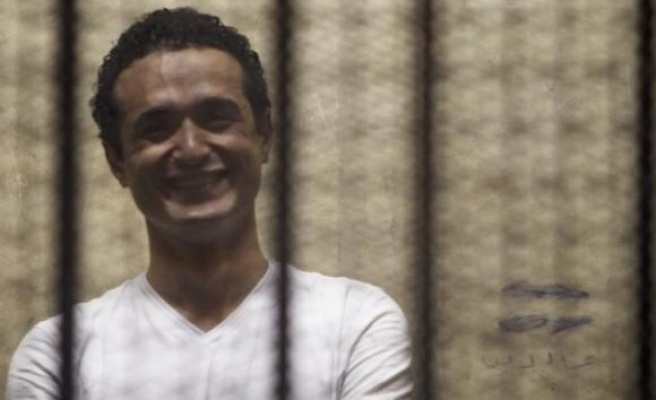 Egypt sentences prominent activist Douma to life in prison