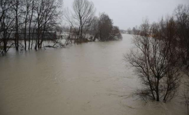 Woman killed in Albanian floods as rain and snow batter Balkans