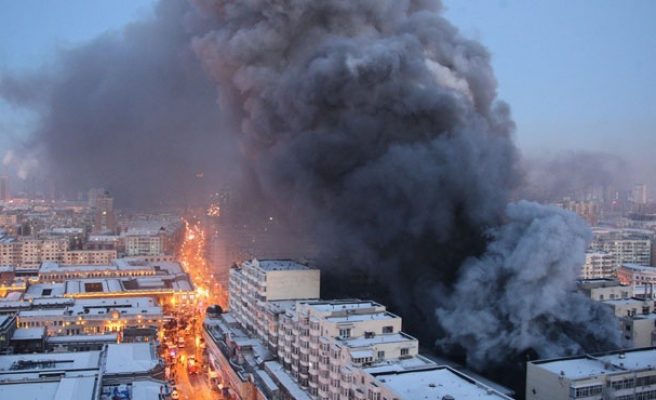 9 detained after China warehouse fire kills 17