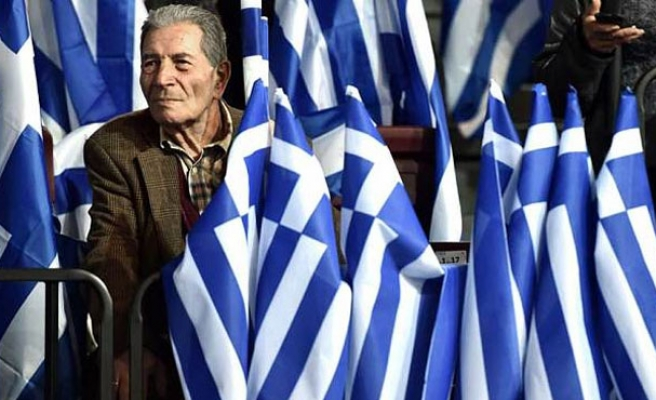 Greece makes more concessions to euro zone, Germany sets vote