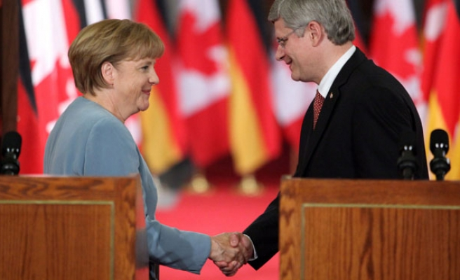 Merkel, Harper meet in Canada to discuss Ukraine