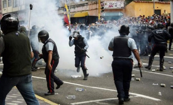 Protests continue in Venezuela as teen shot by police is buried