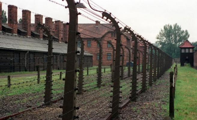 German officials settle refugees in old Nazi camp