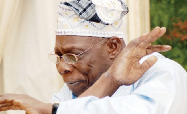 Nigeria's Obasanjo quits ruling PDP in blow to Jonathan