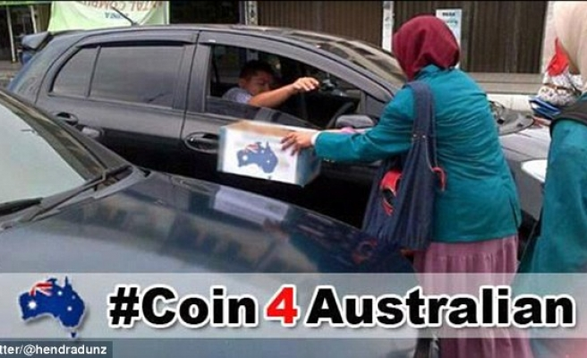 Indonesians protest clemency aid; collect coins