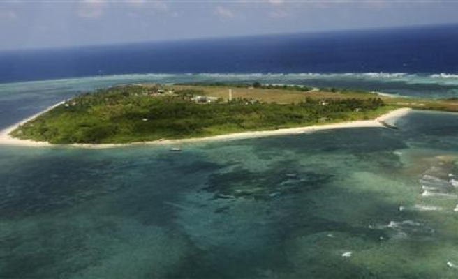 China doing 'large scale' reclamation in disputed islands