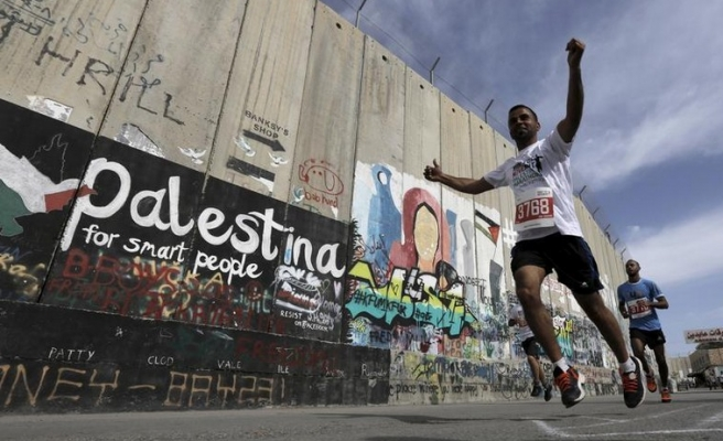 Palestinian athletes hit the wall