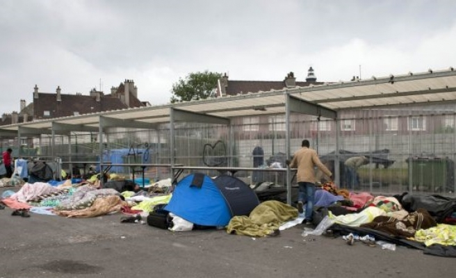 After Calais, France demolishes Paris migrant camp