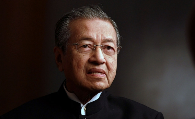 Former Malaysian PM resigns from ruling party