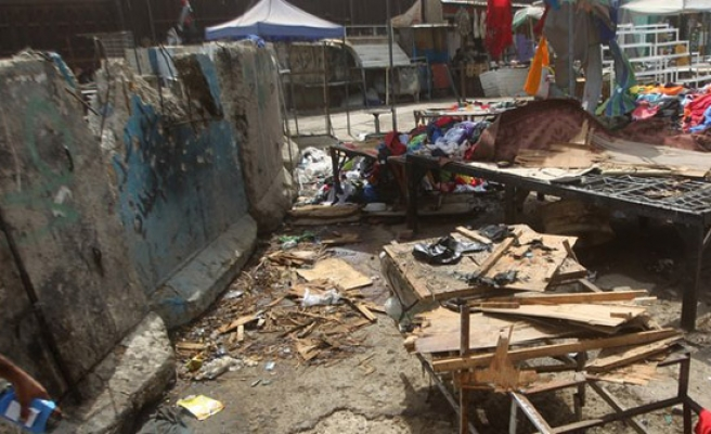 12 killed in two Baghdad car bomb attacks