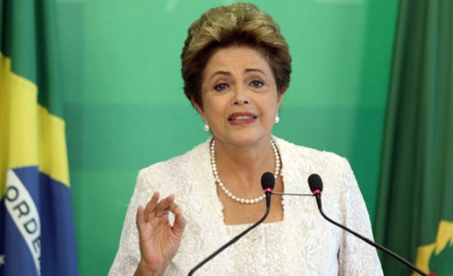 Rousseff axes ministries, cuts her pay by 10%