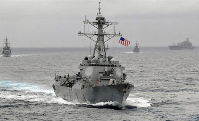 China warns US over provocative acts in South China Sea