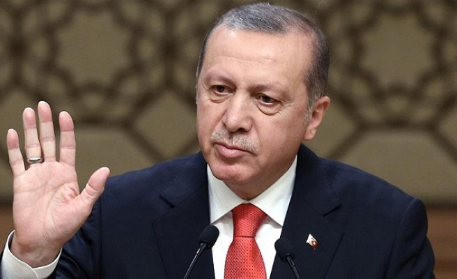 Turkey's Erdogan slams pressure to open borders