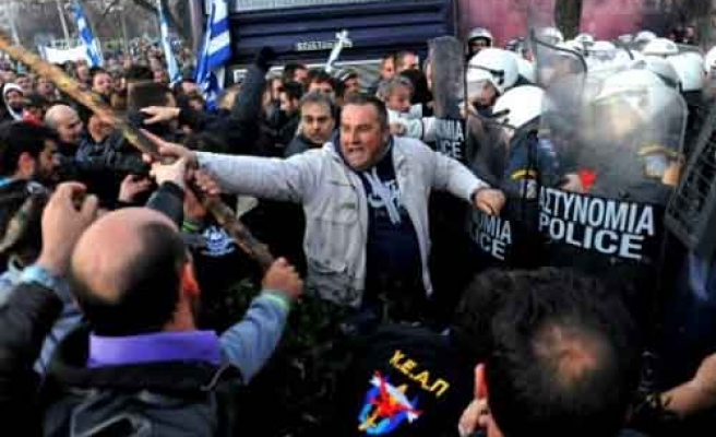 Riot police clash with thousands of Greek farmers