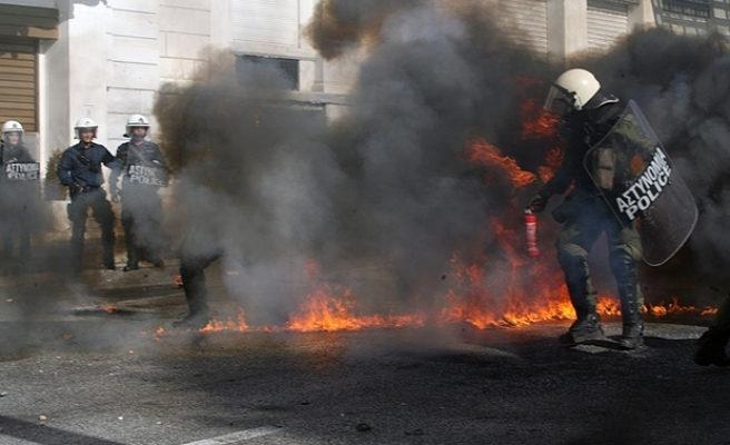General strike with tear gas, Molotov cocktails sweeps Greece