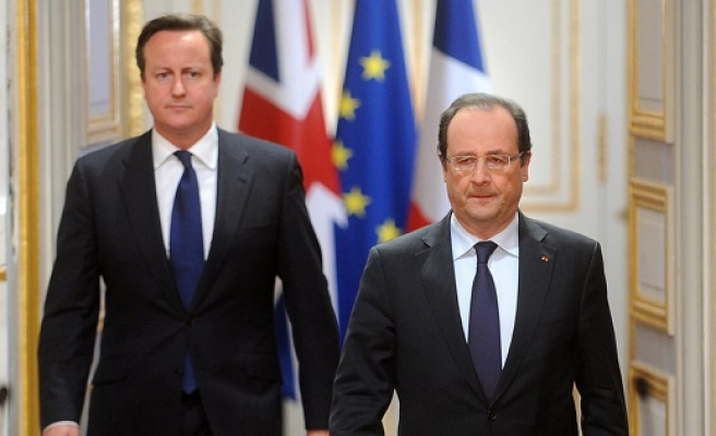 Cameron, Hollande agree 'firm basis' for EU deal