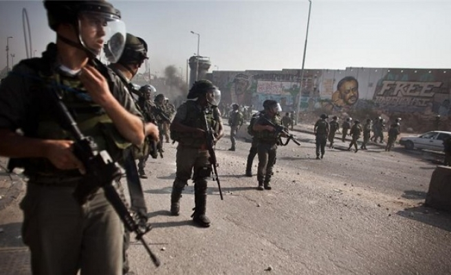 Israeli forces kill Palestinian, wound 10 at refugee camp