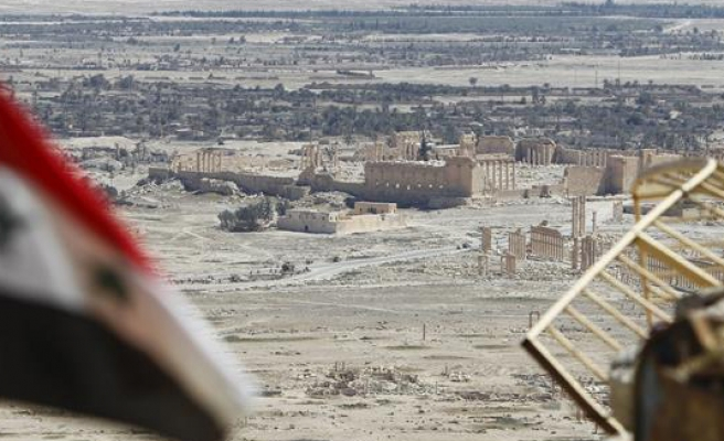 Palmyra mass grave uncovers ISIL tortured women, children