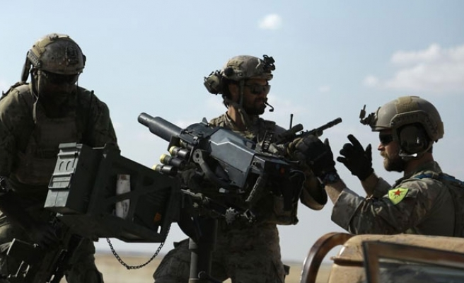 US: not unusual for troops to wear foreign insignia
