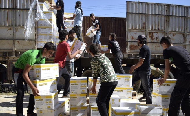 Aid enters besieged area of central Syria