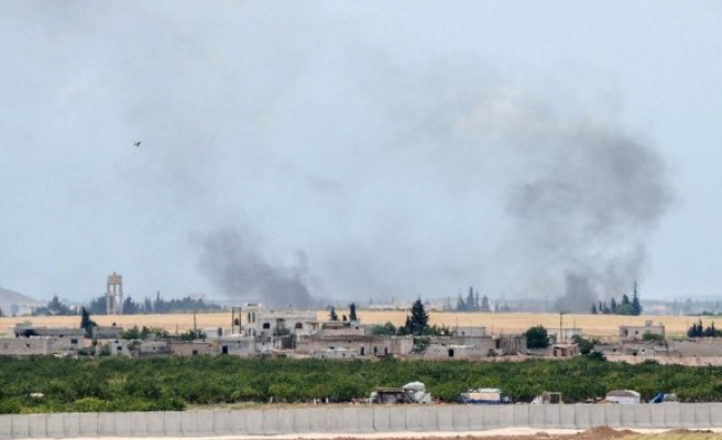 Assad forces suspected of dropping barrel bombs