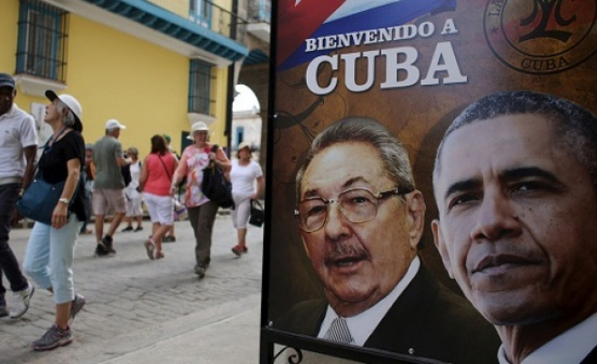 Obama eases Cuba trade rules but blockade remains