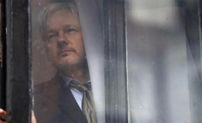 Britain disappointed at UN panel decision on Assange