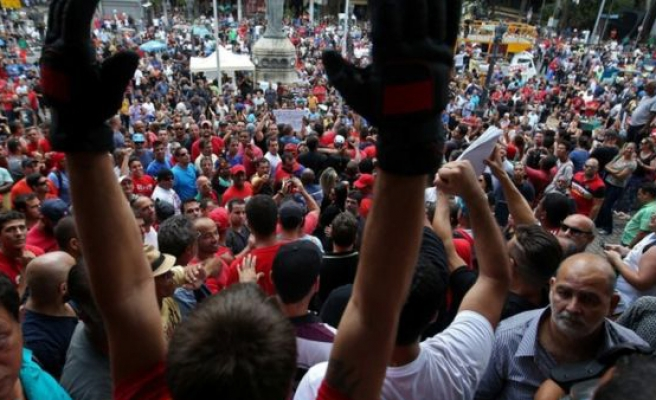 Thousands protest austerity measures in Rio