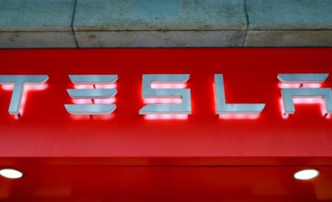 Tesla to lay off 9 percent of workforce