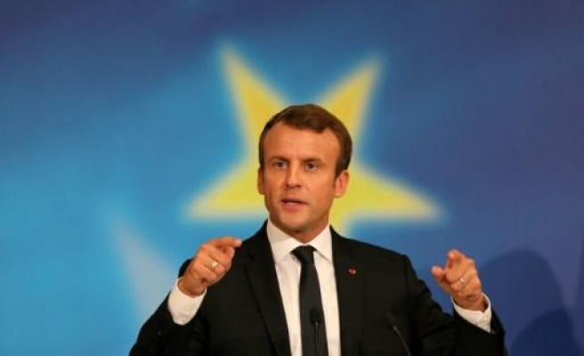 France's Macron unveils tricky first budget