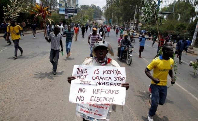 Top Kenyan election official resigns amid protests