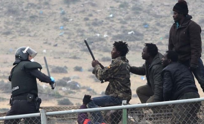 Violence as migrants storm Morocco-Spain border fence