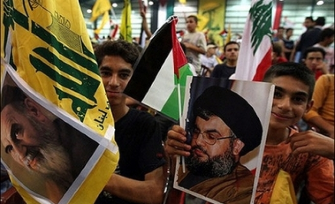 Hezbollah, allies to end armed presence in Beirut