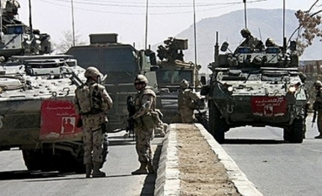 Canadian troops to remain in Afghan until 2011