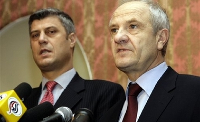 Kosovo leaders sign new country's constitution