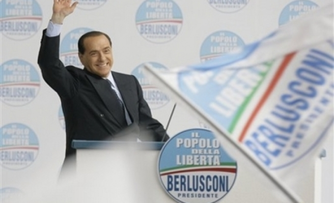 US friend Berlusconi sweeps back to power in Italy election