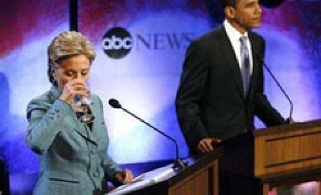 Obama and Clinton on defensive in tense debate