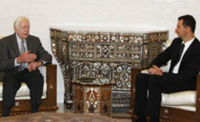 Carter meets Assad in Syria, to see Hamas chief