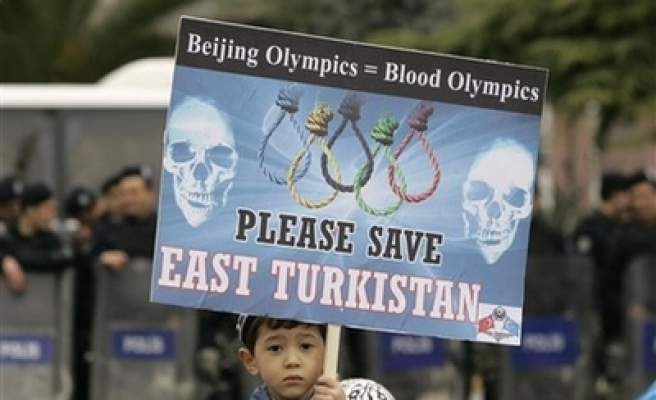 Exiled Uyghurs call for Olympics boycott at Berlin congress