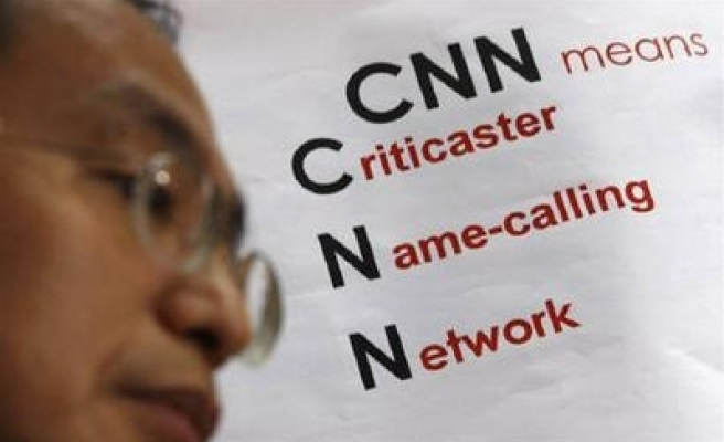 CNN now sued for $1.3 bln - $1 per person in China