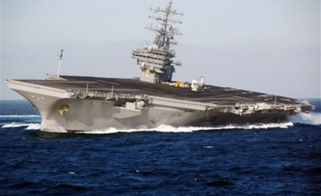 US-contracted ship fires toward Iranian boat
