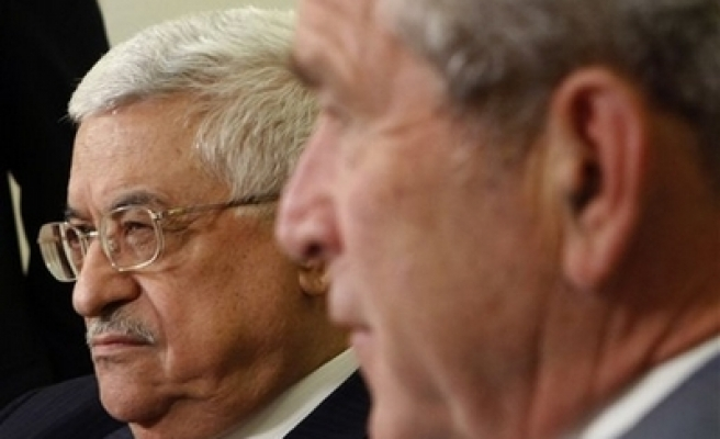 Abbas: We told Bush to stop Jewish settlements