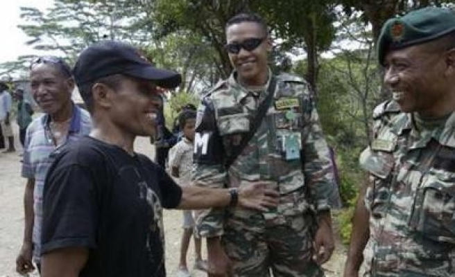 East Timor rebel leader surrenders