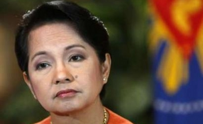 Philippines' Arroyo says to reshuffle cabinet in May