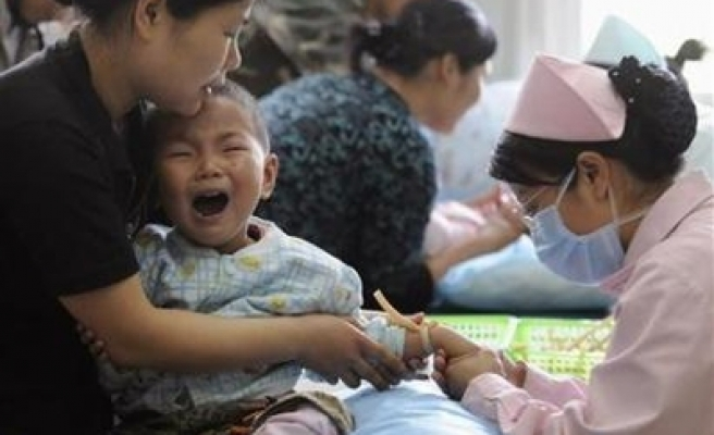 Child virus fears spread to China's capital