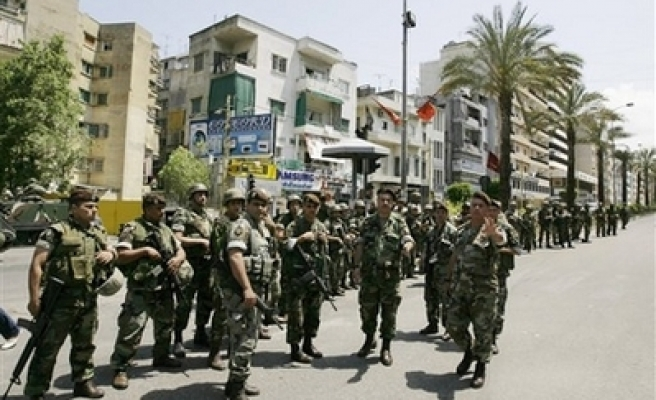 Lebanon troops patrol Beirut after Hezbollah pullout