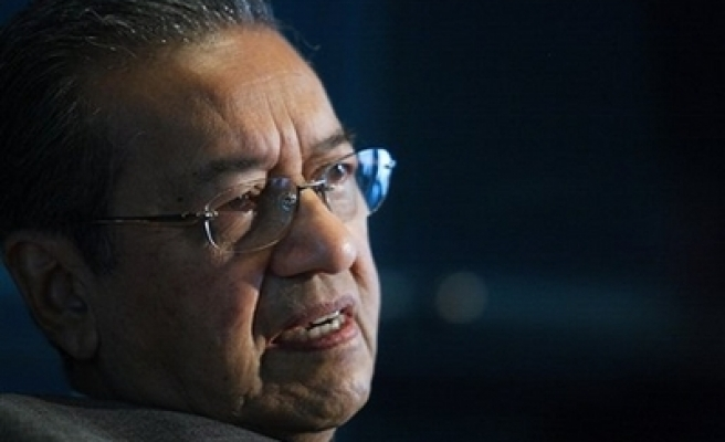Malaysian police grill ex-PM over anti-govt statements