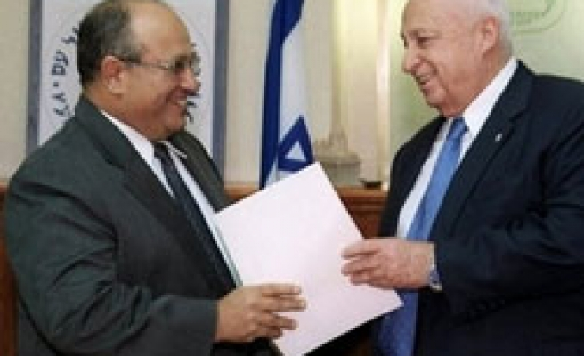 Olmert extends term of office of Mossad chief