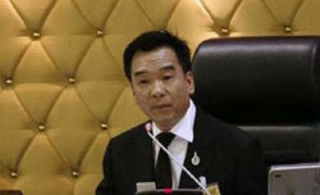 Thai court bans top leader of pro-Thaksin party